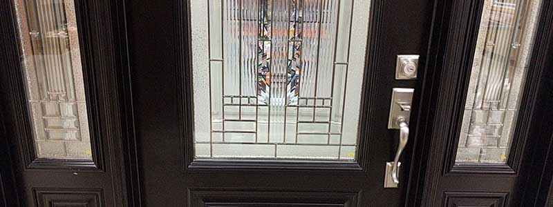 Front entry door made of wood and glass