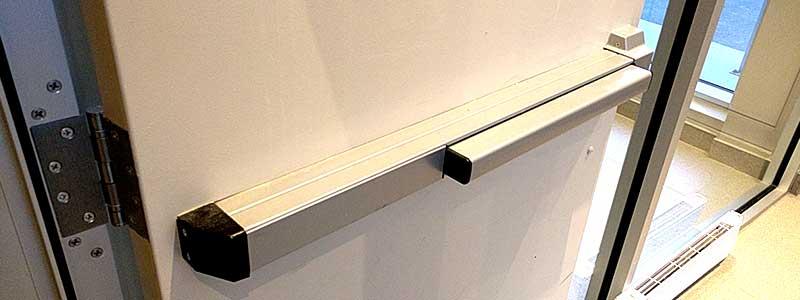 Commercial grade steel door with a push bar